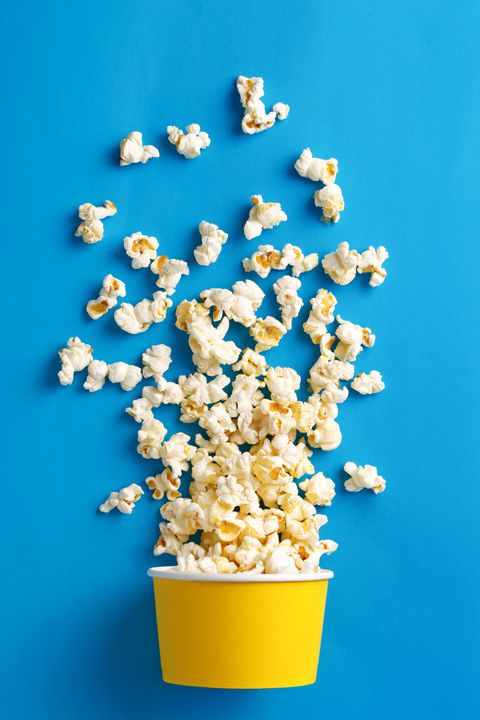 Close-Up Of Popcorn Against Blue Background