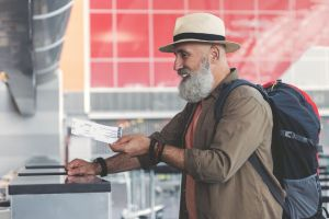Older man checking into airport