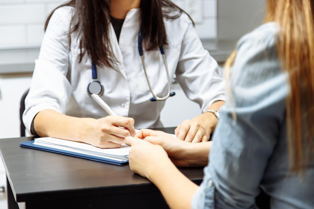 Doctor writing notes on a patient