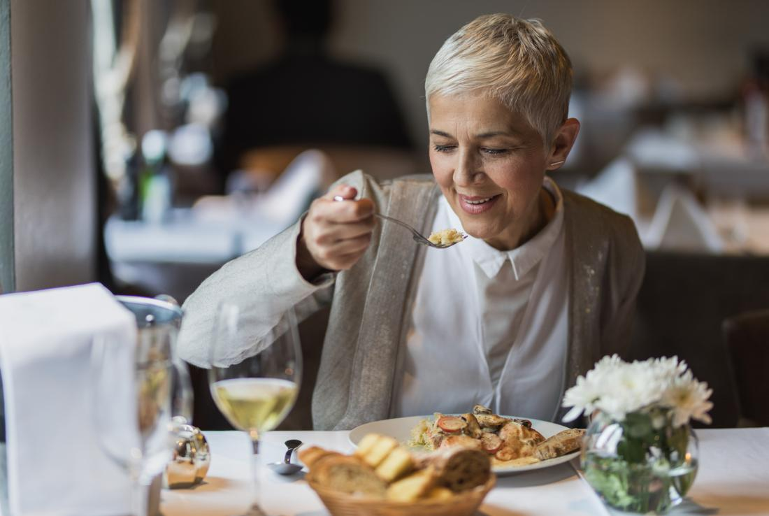 person eating at restaurant