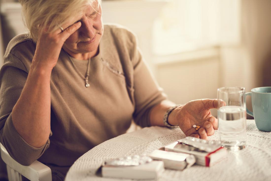 senior taking painkillers