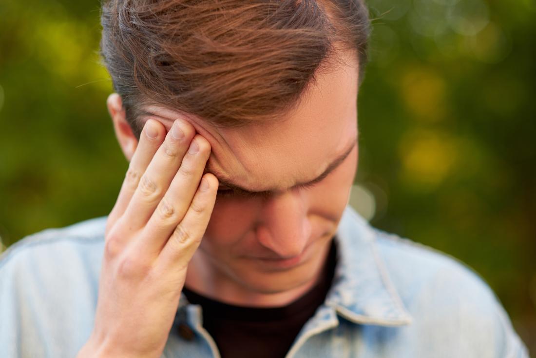 Man holding his head and feeling lightheaded