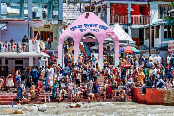 Pilgrims bathed in the Bhagirathi River, at the headwaters of the Ganges, in Gangotri, India.