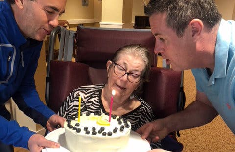 Nigel Smith, right, and his brother celebrate their mother's 81st birthday.