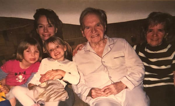 Nora Super, left, holds her nieces, with father Bill Super, center, and aunt Trudy Super.