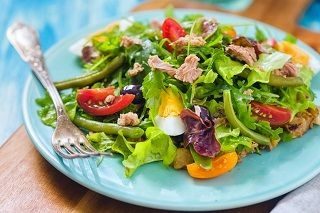 salad on blue plate with fork