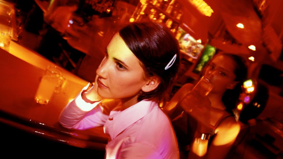 a woman looking confused in a bar because she has taken molly and she is wondering how long it stays in your system