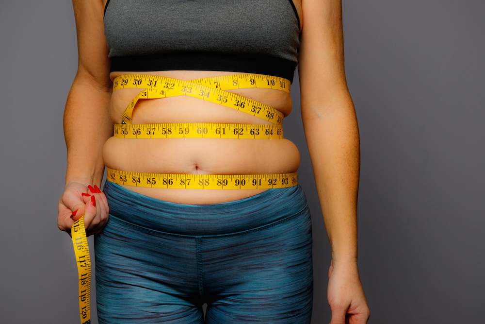 woman-fat-around-middle-measuing-tape-.jpg