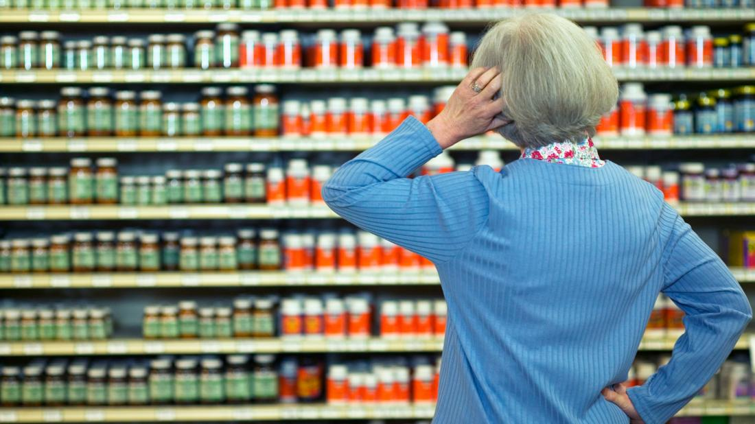 a woman in a shop looking for the Best supplements for lowering blood pressure