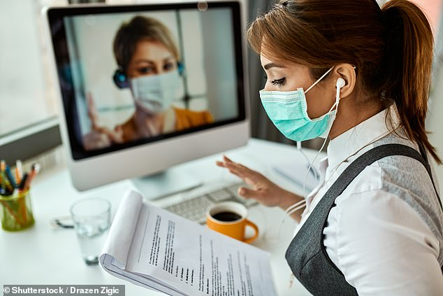 Around one in 20 people in England who had been shielding to avoid catching the coronavirus are not planning on returning to work any time soon (stock, work setting where people wear masks)