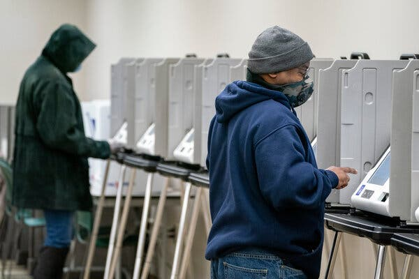 Voters in Ohio, like these in Dayton, can track the status of their ballots on a website, one way the state helps ensure against double voting.