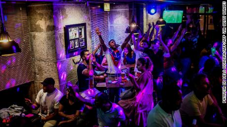 Soccer fans watch a match in Lisbon, Portugal, at a crowded bar on August 12.
