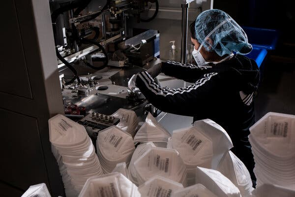 Mask production at Protective Health Gear's factory in Paterson, N.J. The company's chief executive said there were a half million unsold masks sitting in its factory.